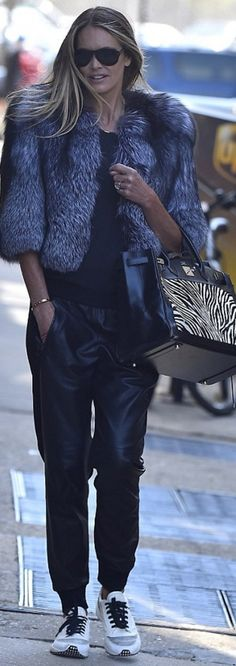 Who made Elle Macpherson's white sneakers and zebra print handbag?