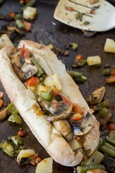 Roasted Vegetable Hoagie is a delicious sub filled with roasted veggies! Mushrooms, green peppers, tomatoes, potatoes and green beans are roasted, thrown in a hoagie roll and then slathered in cheese.