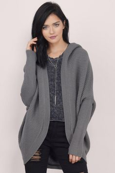 The Fly With Me Oversized Cardigan features winged out sleeves for an oversized look. Includes a hood and cocoon silhouette. Throw over a tee and skinnies for a majorly comfy look. Get 50% off your order when you join Tobi.com