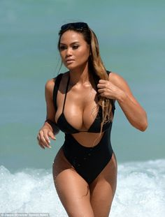 Bathing beauty: The 28-year-old actress and ex-girlfriend of 50 Cent was seen coming out of the ocean in a black string bikini top and one-piece