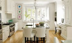 Kitchen, dining and study nook all in one. Great space saver idea.