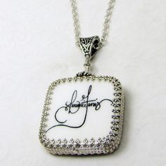 "This is a two-sided Sterling Silver wrapped photo pendant. It's a medium (1"") with the addition of rounded corners."