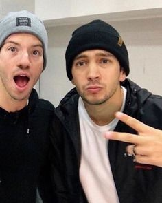 a twenty one pilots pose  honestly they should make a book out of all the poses they do