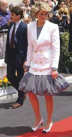 Princess Diana wearing a diagonally striped puffball skirt at Cannes in 1987