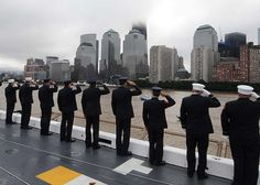 """""""Members of the Fire Department of the City of New York present honors as they pass the World Trade Center and the National September 11 Memorial aboard USS New York"""" by Official U.S. Navy Imagery. Under a Creative Commons license on flickr."""