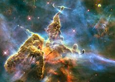 Day 5 of the 2013 Hubble Space Telescope Advent Calendar, one of 25 photos eventually. The stellar nursery of the Carina Nebula. What appears to be a craggy mountaintop enshrouded by wispy clouds, is actually a three-light-year-tall pillar of gas and dust that is being eaten away by the brilliant light from nearby bright stars. The pillar, some 7,500 light-years distant, is also being assaulted from within, as infant stars buried inside it fire off jets of gas that can be seen streaming from…