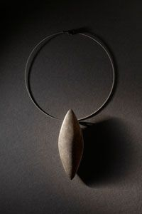 Necklace | Sandra Enterline. 'Shield' 2009  Oxidized Sterling silver, 22K Gold, stainless cable