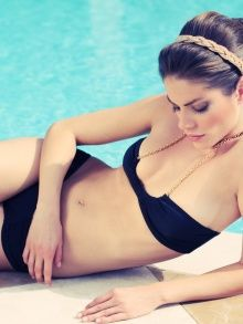 Lounge poolside at Fontainebleau in this black bikini.