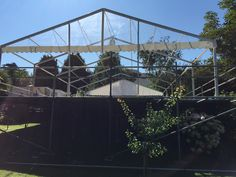 Marquee on scaffolding due to uneven and sloping ground.