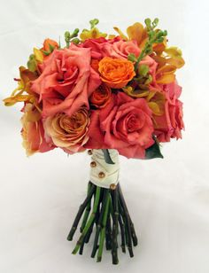 #bridal #bouquet of burnt #orange, #citrus, and #champagne featuring roses and orchids   Bergerons Flowers