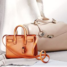 Luxurious leather satchels and structured bags, neutrally.