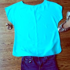 Lilly Pulitzer Sz S Mint Green Top Lilly Pulizter Mint Green Top sz Small. Excellent Condition, no signs of wear at all! 100% silk and a true mint green Lilly color! The second and third photo show color best. Cute gold buttons on back! Make an offer! Lilly Pulitzer Tops Blouses