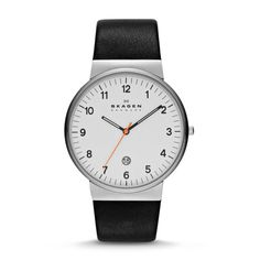 Classic, functional design and supreme quality are trademarks of Skagen, and this timepiece is an excellent example of both. The understated round case is accentuated with black and bright orange hands and a black leather strap.<br><br><b>BEHIND THE DESIGN: </b><br>Iconic yet timeless, this classic watch, with its handsome leather strap, is Danish design at its finest.