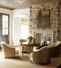 living room, stone wall, arched doorway