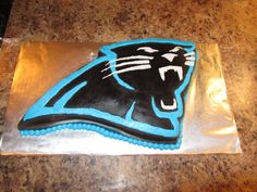 Carolina Panthers Logo Cake - This cake is covered in black fondant with buttercream accents.
