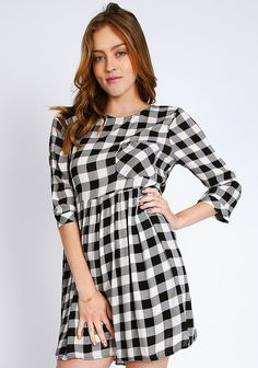White and black plaid smock dress with front pocket, round neckline, 3/4 sleeves and key-hole back with metallic button.