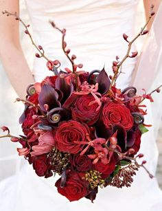 red and black bouquet with red james story orchids and red cymbidium orchids
