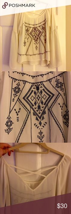 Blu Pepped Embroidered Peasant Top, size L ❤️❤️❤️Blu Pepped sheer embroidered peasant top. Size L (Flowy fit so could fit a M). Is an off white with dark blue embroidery and criss cross on the back and bell sleeves. Purchased from a local boutique and worn once just have so many similar tops.❤️❤️❤️ make an offer! Blu Pepper Tops Blouses