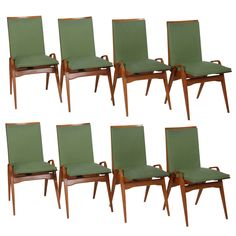 Set of Eight Carlo de Carli Style Pear-Wood Dining Chairs, Italy, 1950s | From a unique collection of antique and modern dining room chairs at https://www.1stdibs.com/furniture/seating/dining-room-chairs/