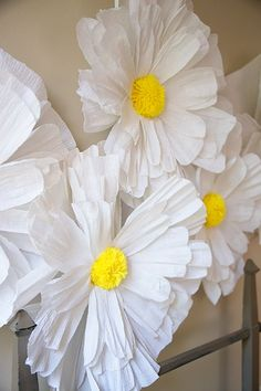 Aug 3, 2017 - Grab your favorite color of crepe paper and some scissors and get to work. We promise this crepe paper daisy backdrop is worth the cutting time!