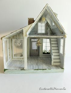And now Whispering Brook Cottage dollhouse with some character added! I tried to photograph the aqua house and lavender door. But it do...