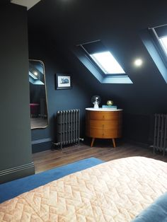 It's winter solstice time (aka the aptly named hibernal solstice) which means it's officially the darkest time of the year. Hence, we're feeling this moody space from shared by ☁️ Attic Bedroom Designs, Attic Bedrooms, Loft Room, Bedroom Loft, Loft Conversion Bedroom, Blue Master Bedroom, Mid Century Bedroom, Loft Spaces, Loft Apartments