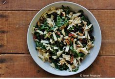 Kale salad with maple vinaigrette, apples, craisins, and nuts. Colorful and delicious, and packed with vitamins and phytonutrients. From http://ouroneacrefarm.com/kale-salad-maple-vinaigrette/