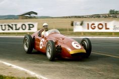 Stirling Moss (Maserati 250F) 5th position, shared with Cesare Perdisa ...