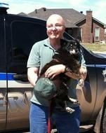 Posted May 28, 2013 An Oklahoma Sheriff's Department officer is credited with helping a lost dog find it's way to the shelter in the aftermath of last week's tornados in Moore. Thanks to the photo of the dog going viral, this sweet little dog has been reunited with her owner.   The story began last week as officers and rescue crews were looking for survivors and came across a small black dog sitting on top of a pile of rubble. This rubble had been a home until a killer tornado ripped it…