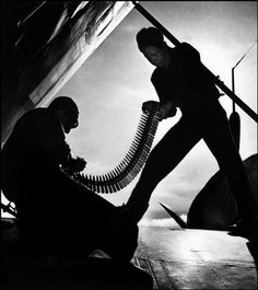 Ammunition being loaded onto planes aboard the USS Bunker Hill aircraft carrier. The Pacific Campaign: 1943. (W. Eugene Smith)