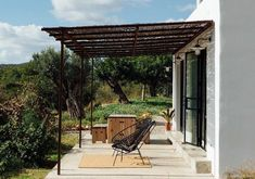 After being abandoned for decades, the Ibiza Campo Loft has been resurrected as a dreamy guest house. The structure is sited on a rural. Ibiza, Steel Windows, Windows And Doors, Casa Cook, Inside Doors, Exclusive Homes, Best Insulation, Timber Cladding, Custom Kitchens