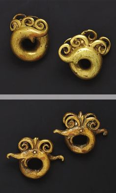 "Indonesia ~ Borneo | ""These pairs of cast golden-hued earrings (Copper alloy, 19th century or earlier), of the Dayak peoples of Kalimantan, are in the shape of double-headed dragon=dogs, a mythological animal known as the aso"" 