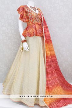 Palkhi fashion exclusive beige crop top lehenga with bandhani choli with bell sleeve look.It is available with two dupattas. Designer Party Wear Dresses, Kurti Designs Party Wear, Indian Designer Outfits, Stylish Blouse Design, Fancy Blouse Designs, Saree Blouse Neck Designs, Bandhani Dress, Lehnga Dress, Choli Designs