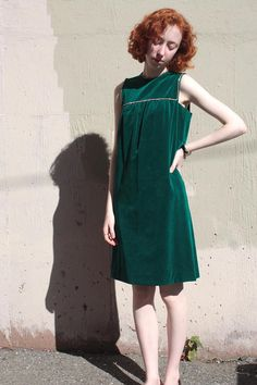 Vintage 1960s emerald green velvet cocktail party dress with rhinestone trim! Babydoll shift fit. Metal zipper up back. MEASUREMENTS: Fits like a Small Bust: 34 Waist: 36 Hips: 37 Length: 37 Arm Hole: 16 CONDITION: Good vintage condition. - - - - - - - - - - - - - - - - - - - - -