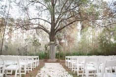 Rustic Outdoor Wedding Ceremony with Light Pink and White Floral Archway under Tall Pines with White Resin Folding Chairs and Rose Petal Aisle | Blue Lane Photography on @marrymetampabay via @aislesociety