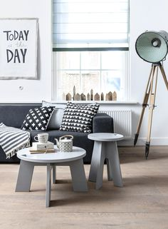 Black, white and grey interior with wooden floors, side table / coffee table and stool Grip by vtwonen, grey couch by Design Sales, Today is the Day poster by The Cherry on Top, industrial light by Neef Louis, accessoires by Livv Lifestyle, Fine Little Day, Nijhof and Sukha Amsterdam. | Styling Kim van Rossenberg | Photographer Sjoerd Eickmans | vtwonen May 2015 | #vtwonencollectie