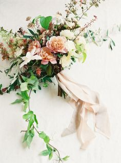 Take everything you love about a Tuscan-style wedding - think gorgeous garland, organic, loose bouquets, and olive branch details and pair it with black tie elegance. The result? This wedding designed bySo Eventful. You'd never know this Italian-inspired day actually took