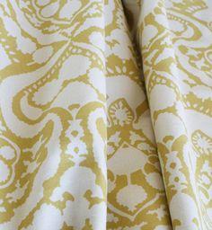 Arabesque Handprint, Sun Fabric by Laura & Kiran. Beautiful golden straw yellow on cream. I love this for curtains/pillows!