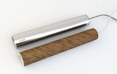 the slim drop-light «lucide» is made of high-grade brush-finished chromium steel, or oiled walnut wood. Designed and made by design-factory (www.d-f.cc)