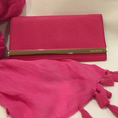 """Michael Kors Pink Clutch Like new! Authentic. This clutch was used for a few hours only. Excellent condition, like new. No signs of use. Still has tags. Genuine leather. Hot pink color. Removable strap. Can be used as a clutch or shoulder bag. 11"""" long x 6"""" high.  Also includes a Michael Kors dust bag. Michael Kors Bags Clutches & Wristlets"""