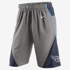 """REPRESENT YOUR TEAM The Nike Fly XL 4.0 (NFL Titans) Men's Training Shorts feature breathable Dri-FIT fabric and a longer inseam for comfort and a natural feel when working out for any sport. Benefits Dri-FIT fabric helps keep you dry and comfortable Mesh fabric at back waist and legs for ventilated comfort Long inseam for a loose fit that lets you move Elastic waist with interior drawcord Product Details 11"""" inseam based on size medium Fabric: Body: Dri-FIT 100% polyester. Mesh: Dri-FIT…"""