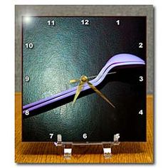 Two Purple Plastic Spoons That Seem to Be SPOONING on Black Background Desk Clock