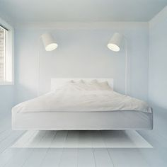 Hard not to like this floating bed.  White lighting works well on white walls.