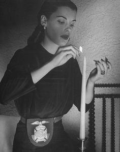 Vintage photography freemason woman lighting candle