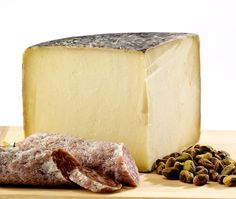 "Cave Aged Marisa - A cave...aged beauty! This natural-rind variety gets its complex, sweet and slightly rambunctious flavors from open-air cave aging. As a judges favorite, Cave Aged Marisa has won many prestigious awards including ""Best of Show"" 1st Runner Up at the 2011 American Cheese Society, 1st Place at the 2012 World Championship Cheese Contest, and 1st Place the 2013 U.S. Championship Cheese Contest."