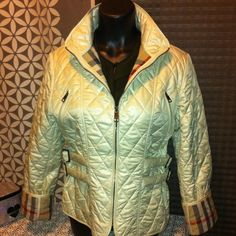 """Burberry Quilted Authentic Coat FinalNO TRADES This coat is a stunner!  It is a medium, arm pit to arm pit measures 20"""" neck to bottom 23.5 and arms are foldable to show off plaid lining please ask questions before purchasing. Burberry Jackets & Coats"""