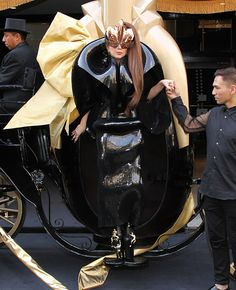 Lady Gaga became a part of her perfume bottle's packaging in this outfit. OMGG hahha