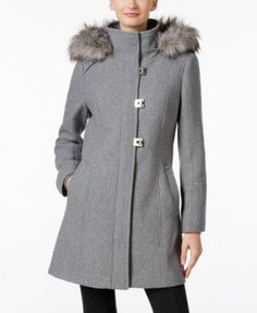 Turnkey buckle closures give this wool-blend walker coat from Calvin Klein a uniquely chic look. | Shell: wool/polyester/cotton/rayon; lining: polyester; faux fur: acrylic/modacrylic/polyester | Dry c