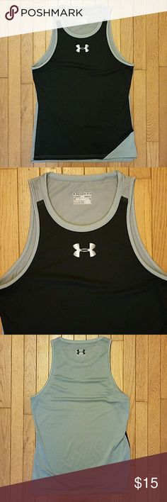 Mens Under Armour Athletic Tank Front panel is made from 100% polyester. Back panel is made from 88% polyester and 12% elastane. This tank is designed to have a loose but aesthetic fit. The fabric is very comfortable and stretchy. Perfect for workouts or casual wear. Worn a few times with some slight signs of pilling throughout the fabric. Under Armour Shirts Tank Tops