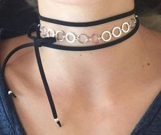 This bolo/choker by Gina Cueto features a sophisticated row of sterling silver rings and is set on a faux leather bolo. Style tip: wrap it around your wrist to wear as a bracelet too. About Gina Cueto